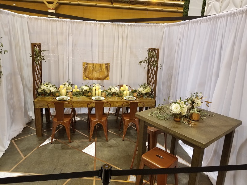 Inspiration Booth with Copper Bistro Chairs and Farm Table