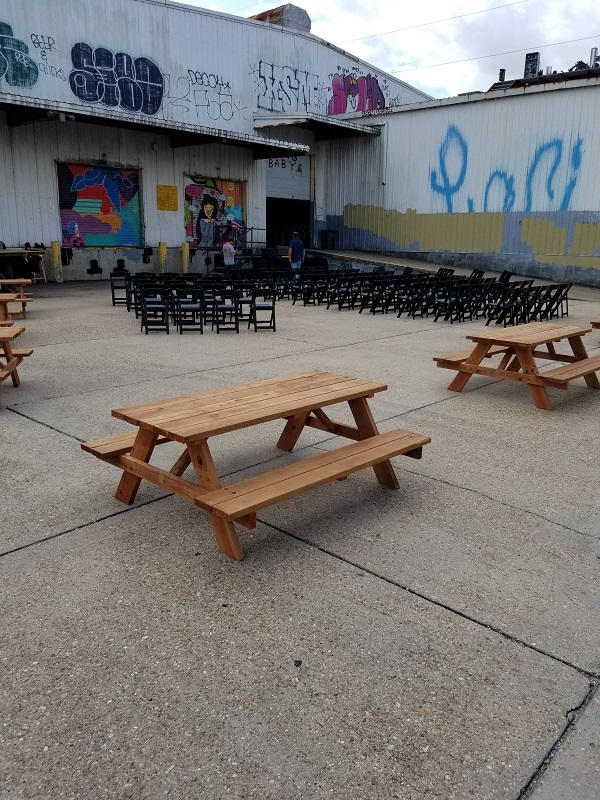 Picnic Tables and Black Padded Chairs
